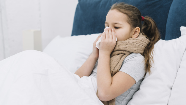 little-girl-lying-bed-suffering-from-cold-cough