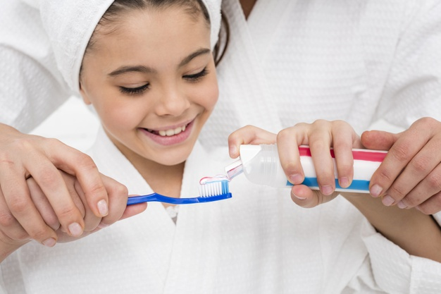 How do you motivate a child to brush teeth?